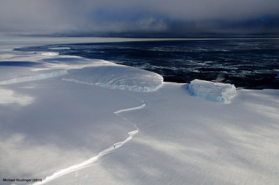 Sea ice and ice bergs in Sulzberger Bay, Ross Sea, Antarctica.