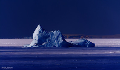 Iceberg trapped in the sea ice in the North Start Bay, Thule.