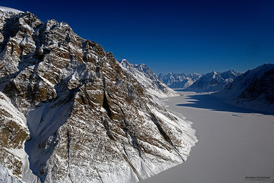 View of the frozen fjord downstream of Violingletscher (Violin Glacier) in Østgrønland (East Greenland) seen during an Operation IceBridge survey flight on April 5, 2014.